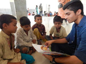 Reading aloud to the children at Nizamuddin