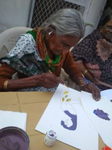 Champiya amma tries her hand at finger painting