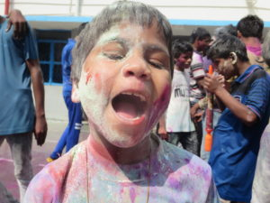 Mohini, playing Holi