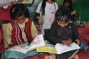 Kids at Modi Mills, reading