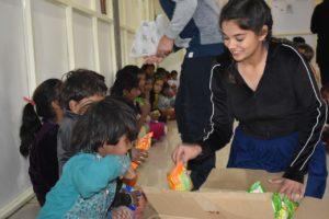 Kashika distributing snacks